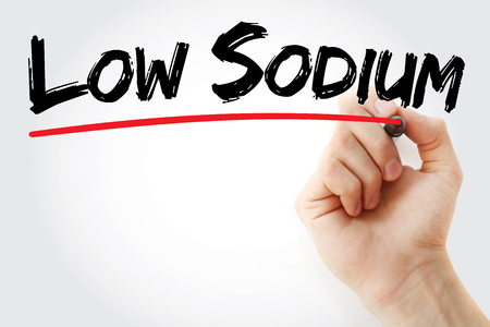 sodium: Hand writing Low Sodium with marker, health concept background