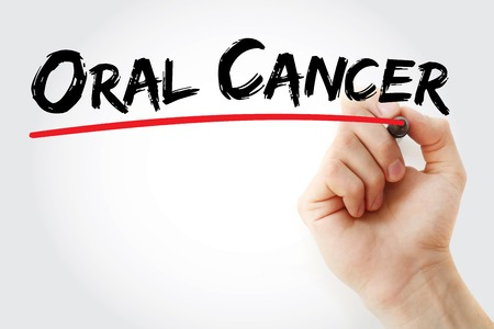 oral cancer: Hand writing Oral Cancer with marker, health concept background