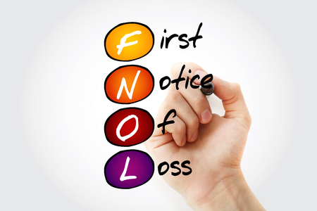 foreclosed: Hand writing FNOL - First Notice Of Loss with marker, acronym business concept