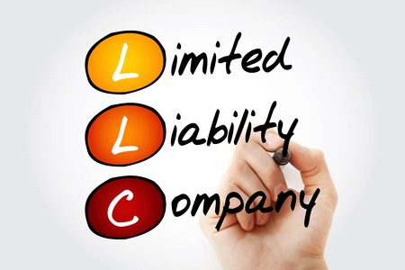 Hand writing LLC - Limited Liability Company with marker, acronym business concept Imagens