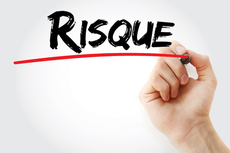 Hand writing Risque (french words for Risk) with marker, business concept