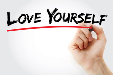egoistic: Hand writing Love Yourself with marker, love concept Stock Photo