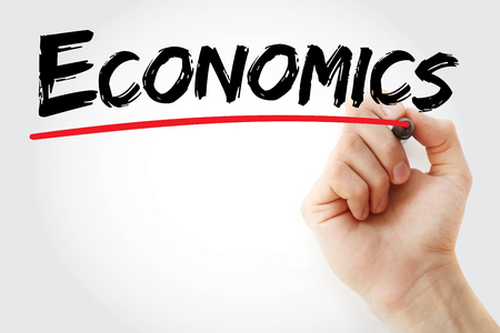 normative: Hand writing ECONOMICS with marker, business concept