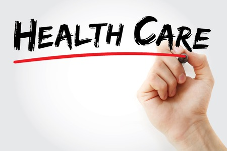 surgery costs: Hand writing Health care with marker, health concept Stock Photo