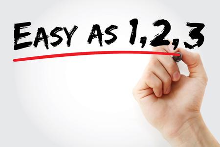 Main qui écrit facile comme 1 2 3 avec le marqueur, fond de concept d'affaires