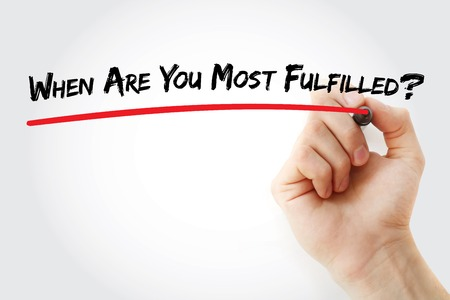Hand writing When Are You Most Fulfilled? with marker, concept background