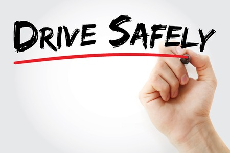 cautionary: Hand writing Drive Safely with marker, concept background Stock Photo