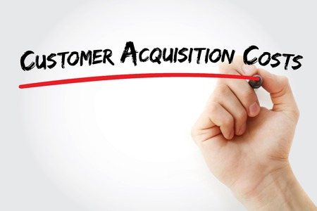 acquisition: Hand writing Customer Acquisition Costs with marker, concept background