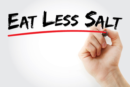 Hand writing Eat Less Salt with marker, concept background