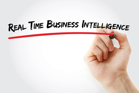 latency: Hand writing Real Time Business Intelligence with marker, concept background Stock Photo