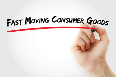 consumer: Hand writing Fast Moving Consumer Goods with marker, concept background Stock Photo