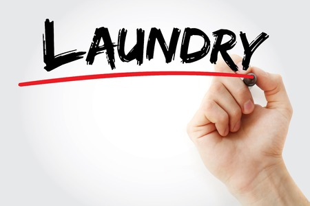 launder: Hand writing Laundry with marker, concept background