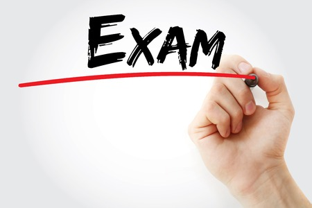 extramural: Hand writing Exam with marker, concept background Stock Photo