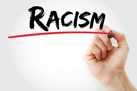 apartheid: Hand writing Racism with marker, concept background Stock Photo