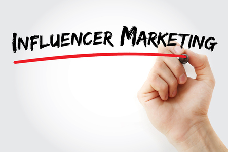 Hand writing Influencer Marketing with marker, concept background
