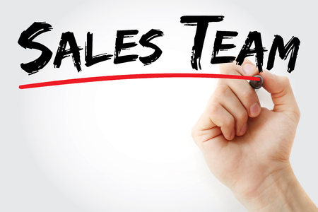 sales team: Hand writing Sales Team with marker, concept background
