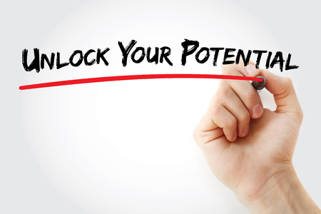 Hand writing Unlock your potential with marker, concept background Stock Photo