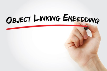embedding: Hand writing Object Linking and Embedding with marker, concept background