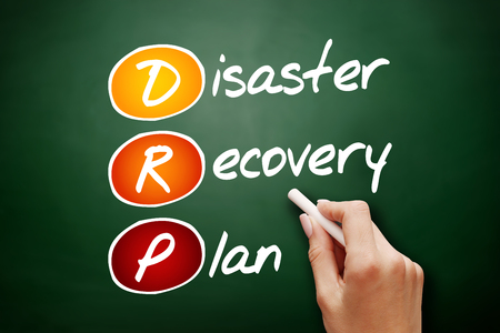 Hand drawn DRP - Disaster Recovery Plan, acronym business concept on blackboard Imagens