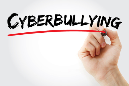 harass: Hand writing Cyberbullying with marker, concept background