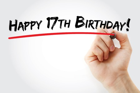 17th: Hand writing Happy 17th birthday with marker, holiday concept background Stock Photo