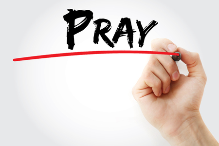 Hand writing PRAY with marker, concept background Stock Photo