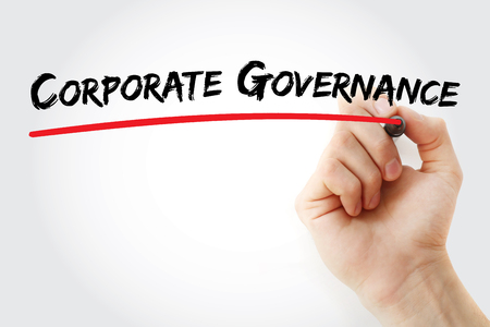corporate governance: Hand writing corporate governance with marker, concept background