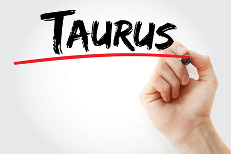 materialistic: Hand writing Taurus with marker, concept background Stock Photo