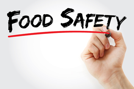 Hand writing Food safety with marker, concept background Stock Photo
