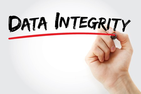 Hand writing data integrity with marker, concept background