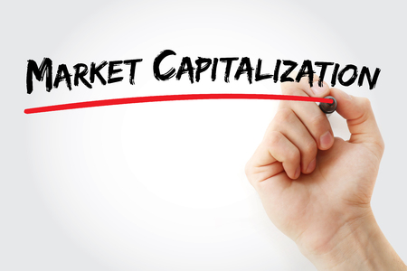 capitalization: Hand writing Market capitalization with marker, concept background