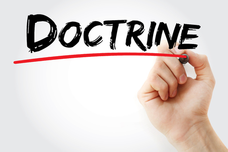 indoctrination: Hand writing Doctrine with marker, concept background Stock Photo