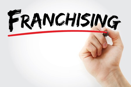 franchising: Hand writing Franchising with marker, concept background