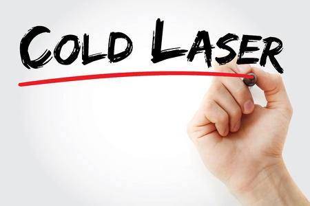 Hand writing Cold laser with marker, concept background 写真素材