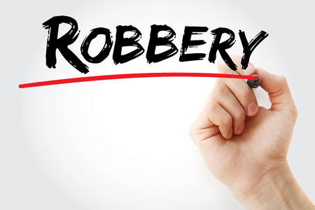 vandalism: Hand writing Robbery with marker, concept background Stock Photo