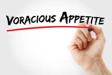 voracious: Hand writing Voracious appetite with marker, concept background