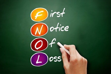 Hand drawn FNOL - First Notice Of Loss, acronym concept on blackboard Stock Photo