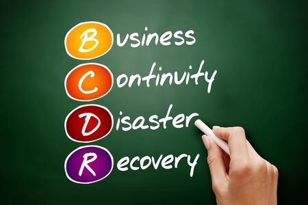 Hand drawn BCDR - Business Continuity Disaster Recovery, acronym concept on blackboard
