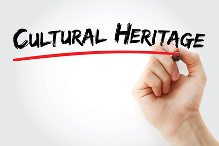 Hand writing Cultural heritage with marker, concept background Stock Photo