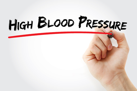 Hand writing High blood pressure with marker, health concept background
