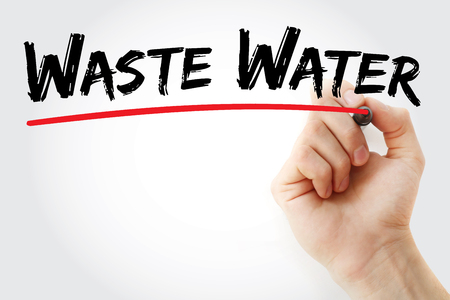 Hand writing Waste water with marker, concept background
