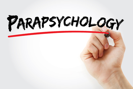 Hand writing Parapsychology with marker, concept background