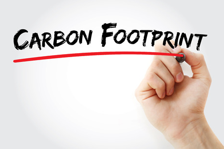 unsustainable: Hand writing Carbon footprint with marker, concept background Stock Photo