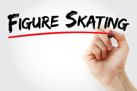 Hand writing Figure skating with marker, sport concept background Stock Photo