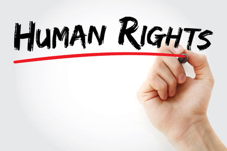 Hand writing Human rights with marker, concept background Stock Photo
