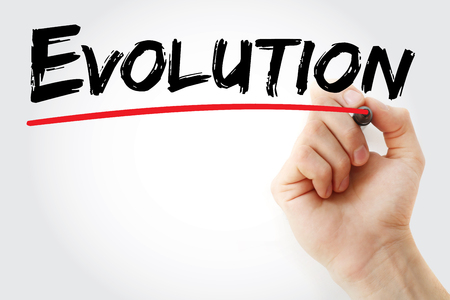 sapiens: Hand writing Evolution with marker, concept background Stock Photo