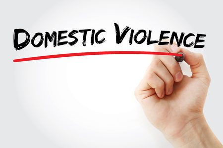 Hand writing Domestic violence with marker, concept background