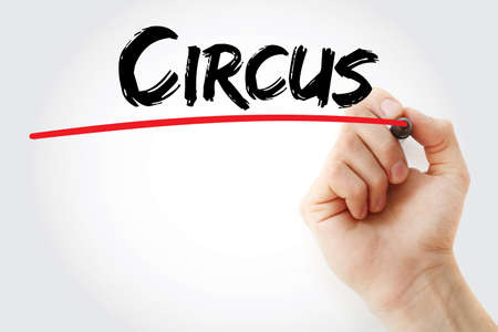 contortion: Hand writing Circus with marker, concept background Stock Photo
