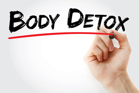 colon cleansing: Hand writing Body detox with marker, concept background