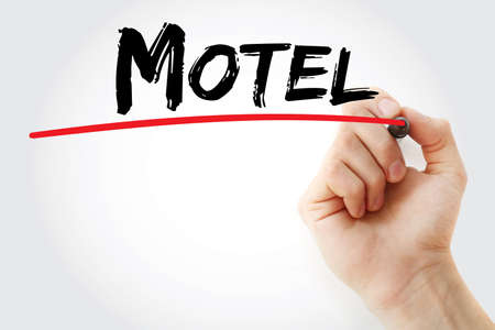 Hand writing motel with marker, concept background